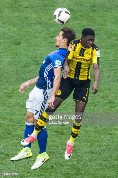 Benjamin Stambouli of Schalke and Ousmane Dembele of Dortmund in action during the Bundesliga match between FC Schalke 04 and Borussia Dortmund at...