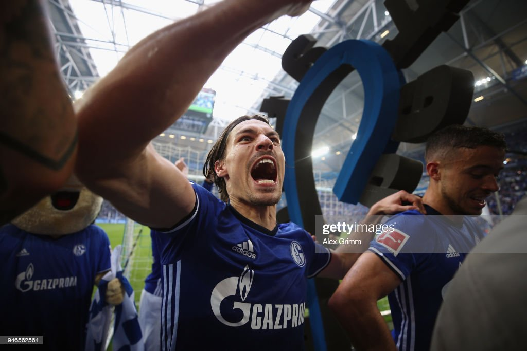 Benjamin Stambouli of Schalke and team mates celebrate after the Bundesliga match between FC Schalke 04 and Borussia Dortmund at Veltins-Arena on April 15, 2018 in Gelsenkirchen, Germany.