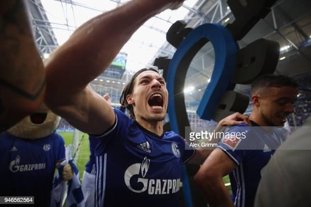 Benjamin Stambouli of Schalke and team mates celebrate after the Bundesliga match between FC Schalke 04 and Borussia Dortmund at VeltinsArena on...
