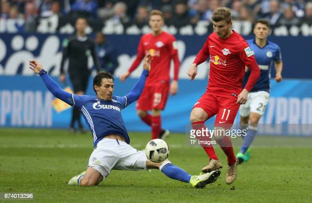 Benjamin Stambouli of Schalke and Timo Werner of Leipzig battle for the ball during the Bundesliga match between FC Schalke 04 and RB Leipzig at...