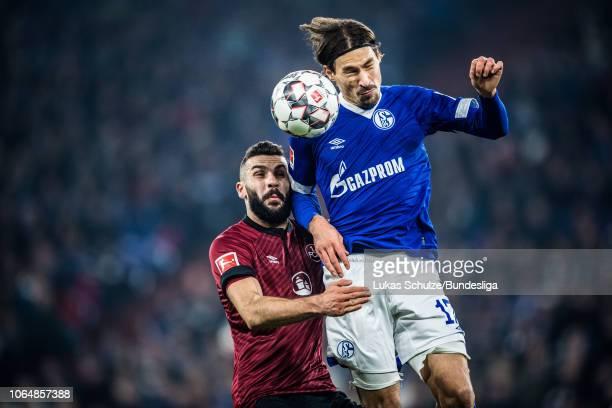 Benjamin Stambouli of Schalke battles for possession with Mikael Ishak of Nuernberg during the Bundesliga match between FC Schalke 04 and 1 FC...