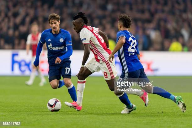 Benjamin Stambouli of Schalke Bertrand Traore of Ajax and Thilo Kahrer of Schalke battle for the ball during the UEFA Europa League Quarter Final...