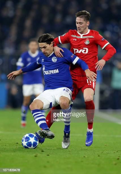 Benjamin Stambouli of Schalke challenges Anton Miranchuk of Moscow during the UEFA Champions League Group D match between FC Schalke 04 and FC...
