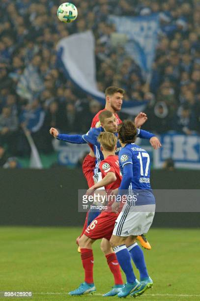 Benjamin Stambouli of Schalke Chris Fuehrich of Koeln Max Meyer of Schalke and Salih Oezcan of Koeln battle for the ball during the Bundesliga match...