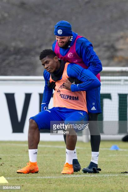 Benjamin Stambouli of Schalke helps Breel Embolo of Schalke during a training session at the FC Schalke 04 Training center on March 14 2018 in...