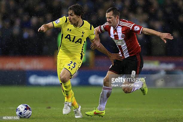 Benjamin Stambouli of Spurs battles with Michael Doyle of Sheff Utd during the Capital One Cup SemiFinal Second Leg match between Sheffield United...