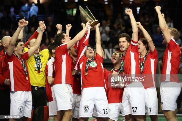 Benjamin Stanzl and his Team of Austria celebrate with the tropy after the Mens Gold Medal Indoor Hockey World Cup Berlin Final Day match between...