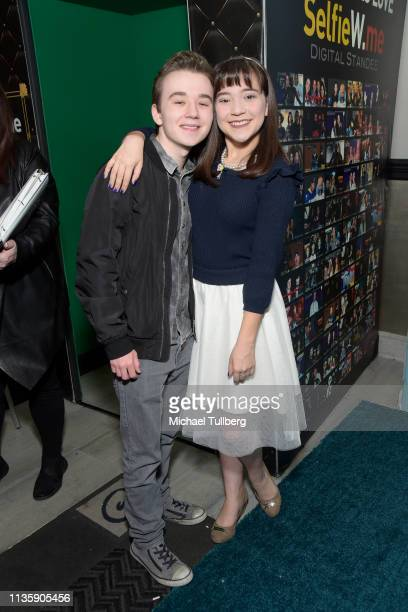 Benjamin Stockham and Chloe Noelle attend a special Los Angeles screening of BYUtv's new series Dwight In Shining Armor at Pacific Theatres at The...