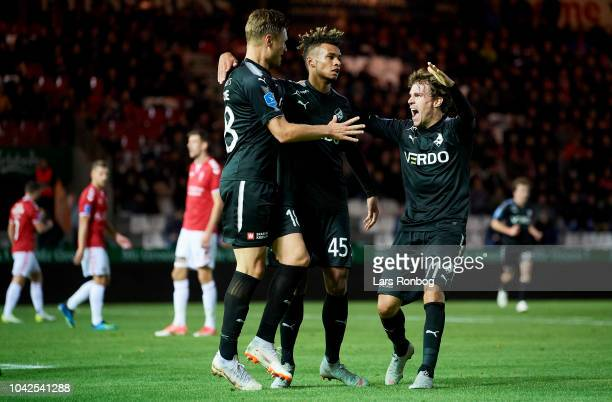 Benjamin Stokke Marvin Egho and Erik Marxen of Randers FC celebrate after scoring their first goal during the Danish Superliga match between Vejle...