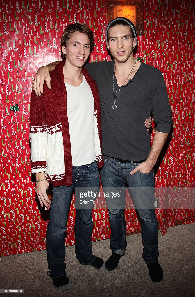 Benjamin Stone (L) and Jesse Kove attend Tacky Christmas Tree skirt party hosted by James Costa on December 16, 2010 in Los Angeles, California.