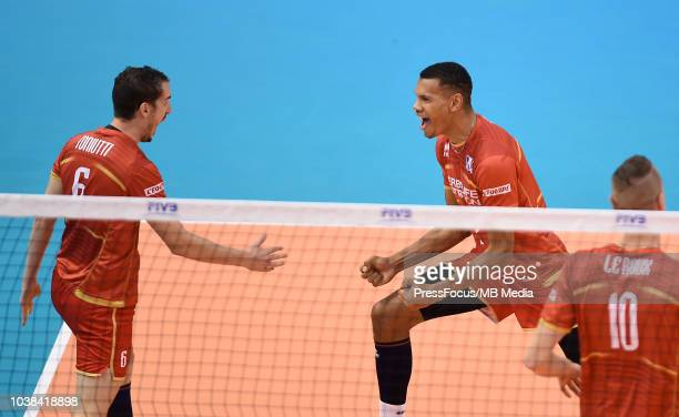 Benjamin Toniutti and Stephen Boyer of France celebrate after a point during FIVB World Championships match between France and Argentina on September...