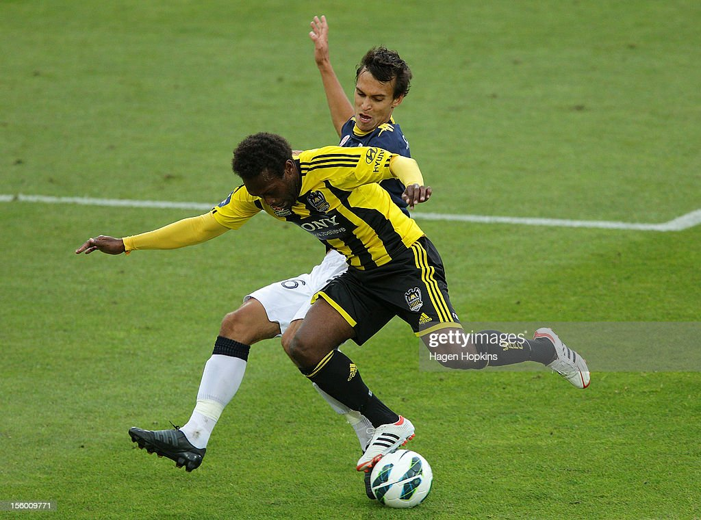 Benjamin Totori of the Phoenix is tackled by Trent Sainsbury of the Mariners during the round six A-League match between the Wellington Phoenix and the Central Coast Mariners at Westpac Stadium on November 11, 2012 in Wellington, New Zealand.