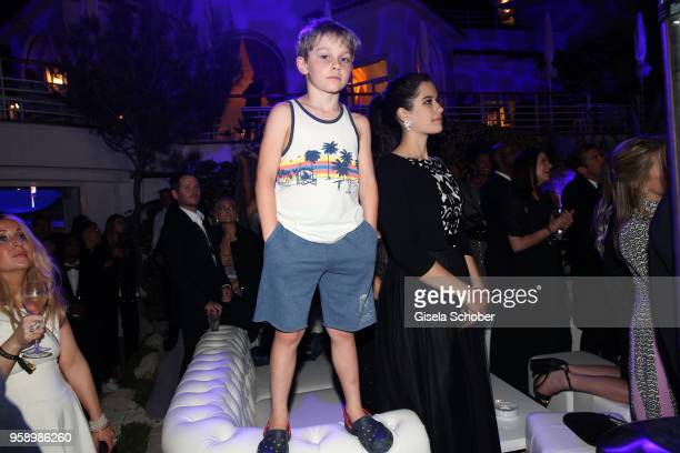 Benjamin Travolta son of John Travolta and Kelly Preston and his sister Ella Bleu Travolta during the party in Honour of John Travolta's receipt of...