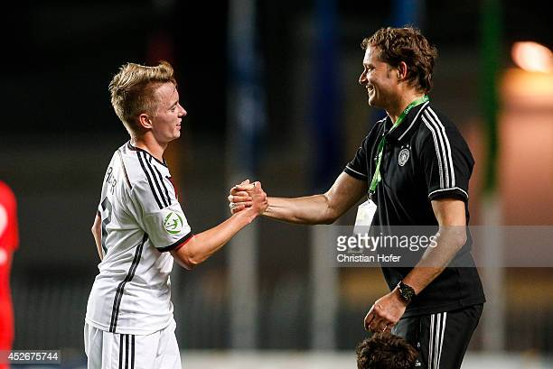 Benjamin Truemmer and Coach Marcus Sorg of Germany celebrate after winning the UEFA Under19 European Championship match between U19 Germany and U19...