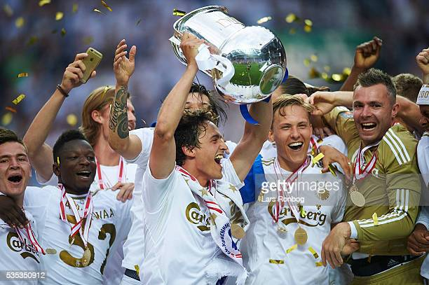 Benjamin Verbic Danny Amankwaa Thomas Delaney Ludvig Augustinsson and Stephan Andersen of FC Copenhagen lifts the trophy and celebrate with teammates...