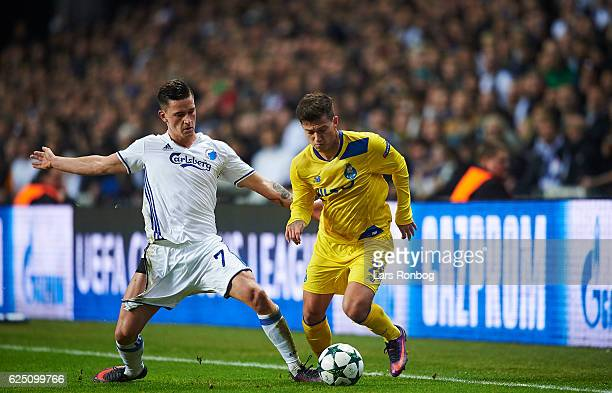 Benjamin Verbic of FC Copenhagen and Otavio of FC Porto compete for the ball during the UEFA Champions League match between FC Copenhagen and FC...