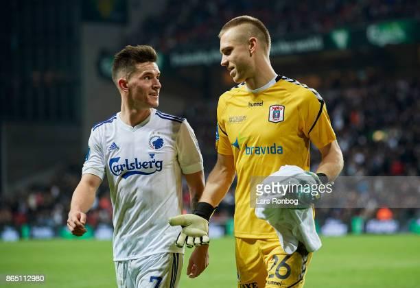 Benjamin Verbic of FC Copenhagen speaks to Goalkeeper Aleksandar Jovanovic of AGF Aarhus during halftime in the Danish Alka Superliga match between...