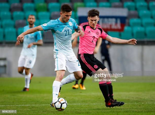 Benjamin Verbic of Slovenia in action against Kieran Tierney of Scotland during the FIFA 2018 World Cup Qualifier match between Slovenia and Scotland...
