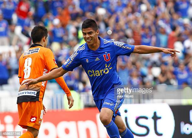 Benjamin Vidal of U de Chile celebrates after scoring his team's forth goal during a match between Cobreloa and U de Chile as part of round 14 of...