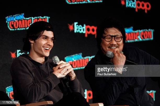 Benjamin Wadsworth and Benedict Wong speak onstage at the 'Deadly Class' panel during 2019 New York Comic Con at Jacob Javits Convention Center on...