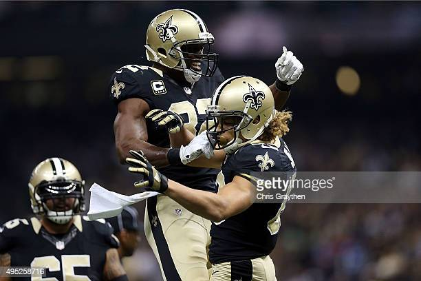 Benjamin Watson celebrates with Willie Snead of the New Orleans Saints following a touchdown during the first quarter of a game against the New York...