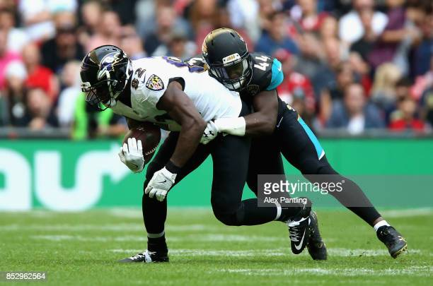 Benjamin Watson of the Baltimore Ravens is tackled by Myles Jack of the Jacksonville Jaguars during the NFL International Series match between...