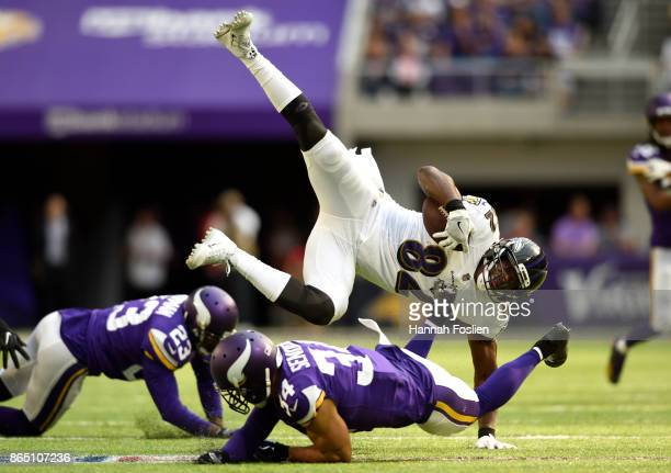 Benjamin Watson of the Baltimore Ravens is upended by Andrew Sendejo of the Minnesota Vikings in the second quarter of the game on October 22 2017 at...