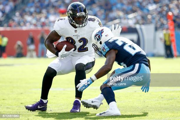 Benjamin Watson of the Baltimore Ravens pushes off a tackle by Adoree' Jackson of the Tennessee Titans during the first half at Nissan Stadium on...