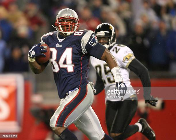 Benjamin Watson of the New England Patriots runs for a touchdown in front of Kenny Wright of the Jacksonville Jaguars during their Wildcard Playoff...
