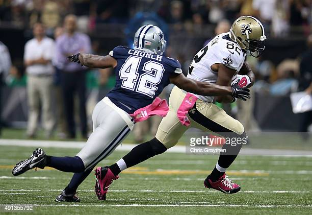 Benjamin Watson of the New Orleans Saints carries the ball as Barry Church of the Dallas Cowboys defends during the second quarter against the Dallas...