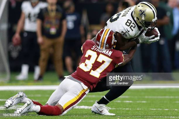 Benjamin Watson of the New Orleans Saints is tackled by Greg Stroman of the Washington Redskins during the second half at the MercedesBenz Superdome...