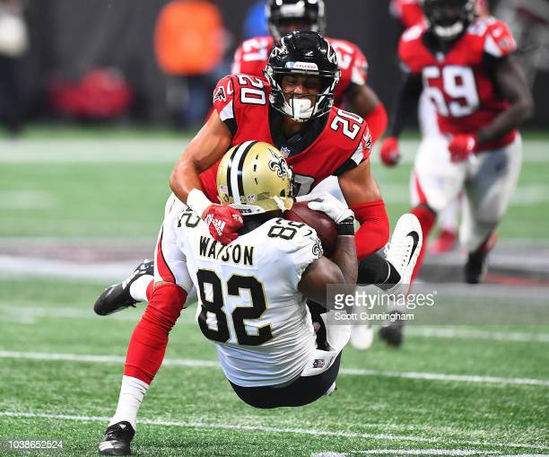 Benjamin Watson of the New Orleans Saints is tackled by Isaiah Oliver of the Atlanta Falcons during the third quarter at MercedesBenz Stadium on...