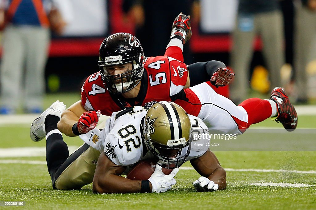 Benjamin Watson #82 of the New Orleans Saints is tackled by Nate Stupar #54 of the Atlanta Falcons after a reception during the second half at the Georgia Dome on January 3, 2016 in Atlanta, Georgia.