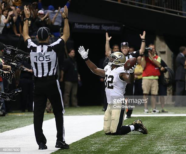 Benjamin Watson of the New Orleans Saints scores a touchdown during the third quarter of a game against the Atlanta Falcons at the MercedesBenz...