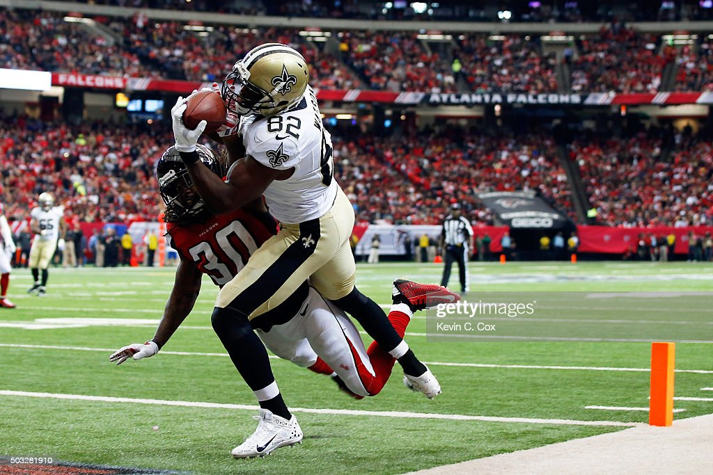 Benjamin Watson #82 of the New Orleans Saints scores a touchdown over Charles Godfrey #30 of the Atlanta Falcons during the first half at the Georgia Dome on January 3, 2016 in Atlanta, Georgia.