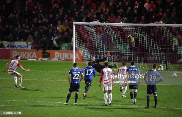 Benjamin Whiteman of Doncaster Rovers scores a penalty for his team's second goal during the FA Cup Fourth Round match between Doncaster Rovers and...