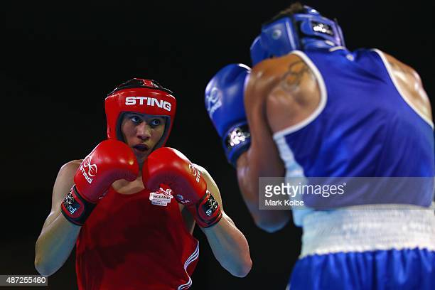 Benjamin Whittaker of England and Siaosi Fenukitau of Tonga box during their youths 75kg quarterfinal bout at the Tuanaimato Sports Facility on day...