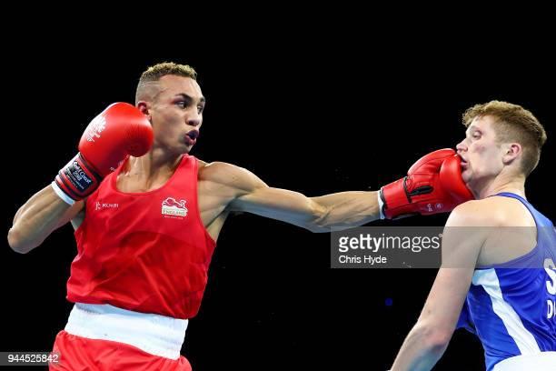 Benjamin Whittaker of EnglandÊand John Docherty of ScotlandÊcompete in the Men's 75kg quarterfinal Boxing on day seven of the Gold Coast 2018...