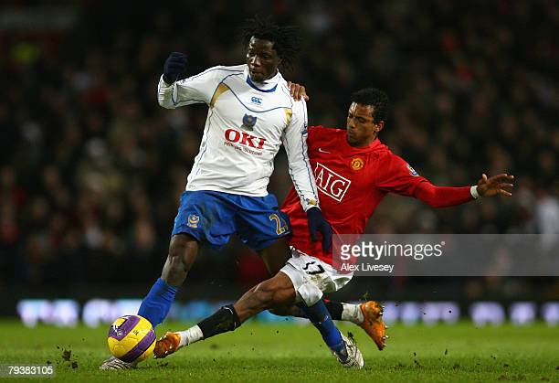 Benjani Mwaruwari of Portsmouth is tackled by Nani of Manchester United during the Barclays Premier League match between Manchester United and...