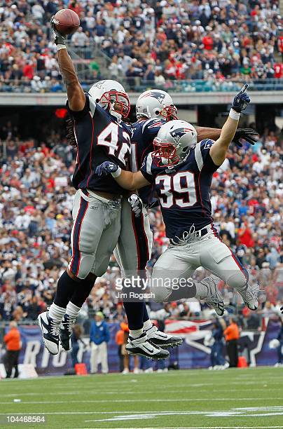 BenJarvus GreenElllis of the New England Patriots celebrates his touchdown with teammates Sammy Morris and Danny Woodhead in the second half against...