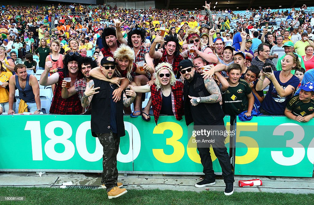 Benji and Joel Madden pose with fans just prior to commencement of the Twenty20 international match between Australia and Sri Lanka at ANZ Stadium on January 26, 2013 in Sydney, Australia.