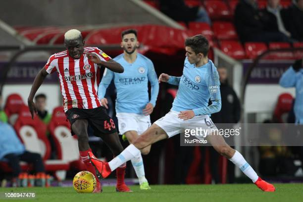Benji Kimpioka and Iker Pozo in action during the Checkatrade Trophy Quarter Final match between Sunderland and Manchester City Under 23s at the...