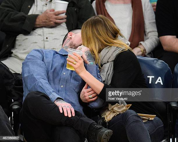 Benji Madden and Cameron Diaz kiss at a basketball game between the Washington Wizards and the Los Angeles Lakers at Staples Center on January 27...