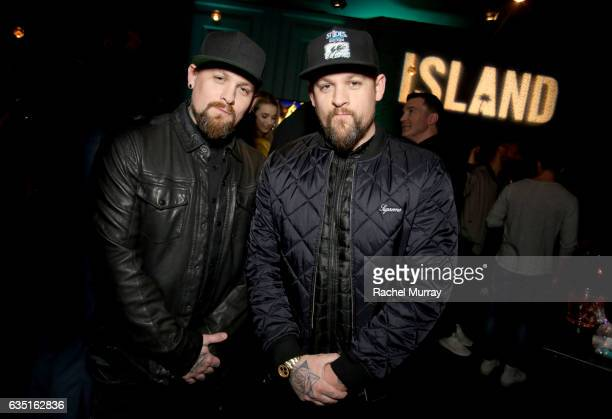 Benji Madden and Joel Madden attend Island Records PreGrammy Party presented by Foursquare with additional partners Young Living Ultimate Ears and...