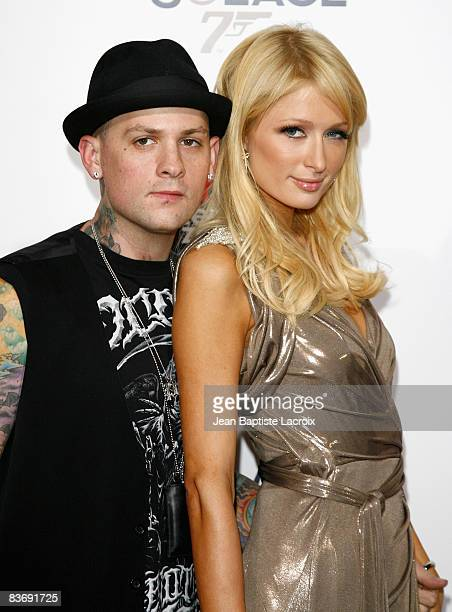 Benji Madden and Paris Hilton arrives at the prescreening of Bond 007 Quantum Of Solace on November 13 2008 in Los Angeles California