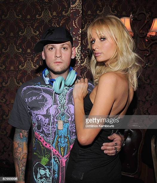 Benji Madden and Paris Hilton attend the grand opening of Haven nightclub on September 24, 2008 in New York City.