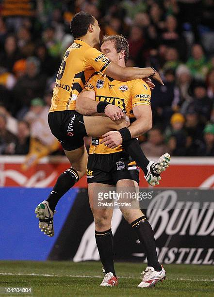 Benji Marshall and Gareth Ellis of the Tigers celebrate a try during the first NRL semi final match between the Canberra Raiders and the Wests Tigers...