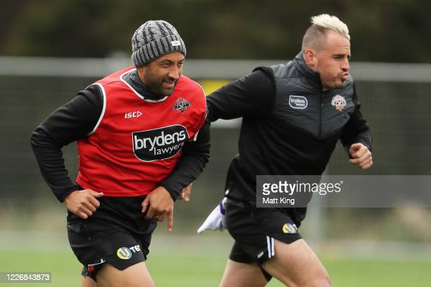 Benji Marshall and Josh Reynolds warm up during a Wests Tigers NRL training session at St. Luke's Park North on May 25, 2020 in Sydney, Australia.