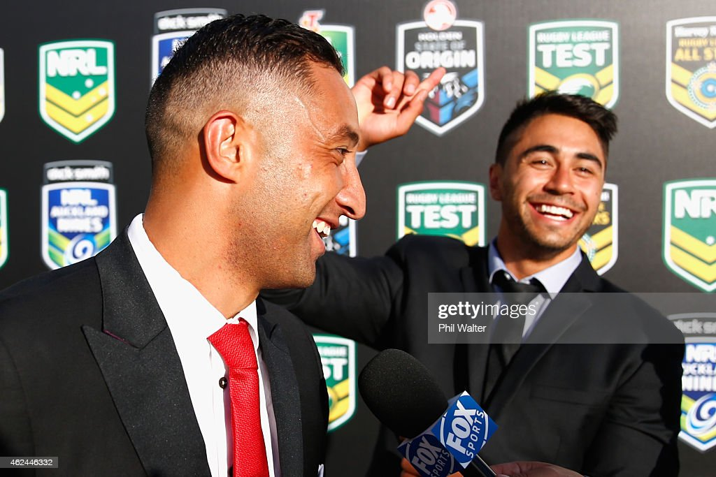 Benji Marshall (L) and Shaun Johnson (R) share a joke before the 2015 NRL season launch at Shed 10 on January 29, 2015 in Auckland, New Zealand.