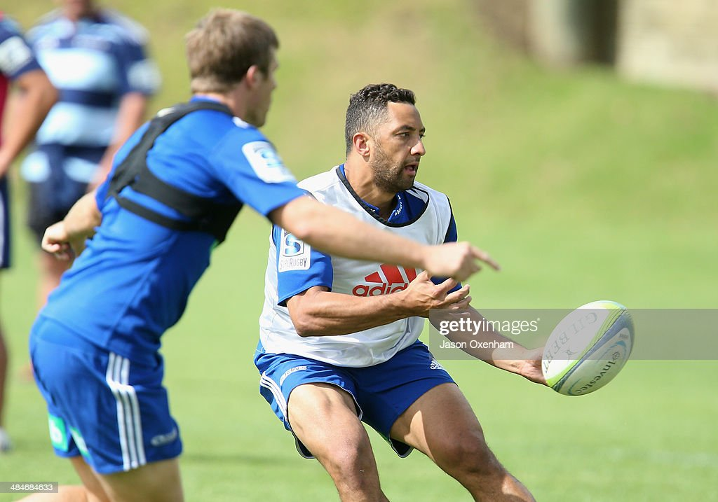 Benji Marshall of the Blues gets a pass away under pressure from team-mate Chris Noakes (L) during an Auckland Blues Super Rugby training session at Unitec on April 14, 2014 in Auckland, New Zealand.